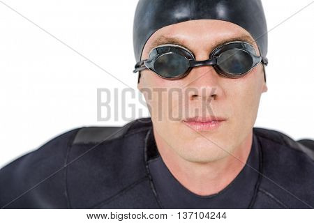 Close-up of confident swimmer in wetsuit on white background