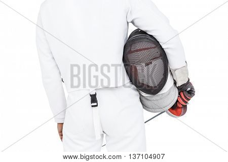Rear view of swordsman holding fencing mask and sword on white background