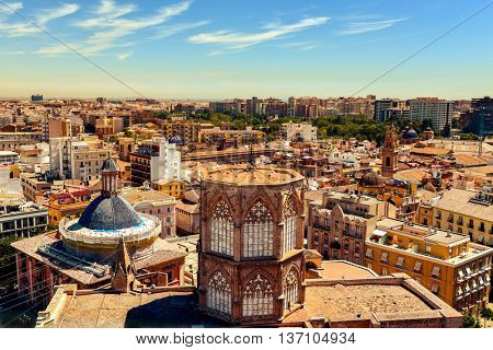 an aerial view of the roof of the Cathedral and the old town of Valencia, Spain, as seen from the Micalet, the belfry, highlighting the blue tiled dome of the Basilica de la Virgen de los Desamparados