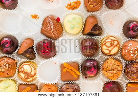 incomplete box of delicious handmade chocolates closeup