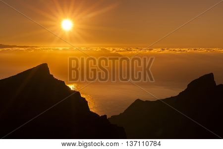 Sunset overlooking mountain ridge and the Atlantic Ocean on the Canary Islands