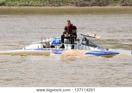 Madison Indiana - July 2 2016: Danny Walls sits on his GNH 68 hydroplane while being towed to the pit area at the Madison Regatta in Madison Indiana July 2 2016.