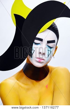 Body art with a headpiece. Yellow body-paint.