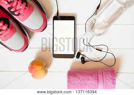 Red Sneakers With Towel, Peach, Bottle With Water, Smartphone With Empty Screen With Headphones On W