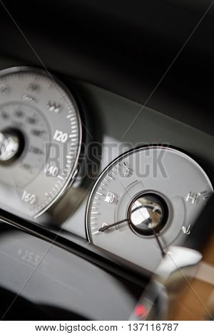 Close up shot of a car's dashboard with the fuel gauge.