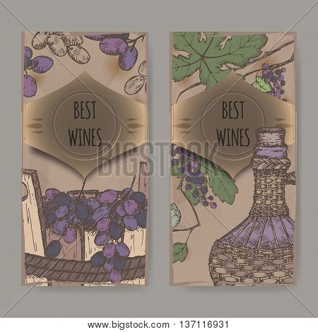 Set of two color vintage wine label templates with grapes in wooden bucket and bottle in wicker case. Placed on old paper background. Great for wineries, grocery stores, wine label design.