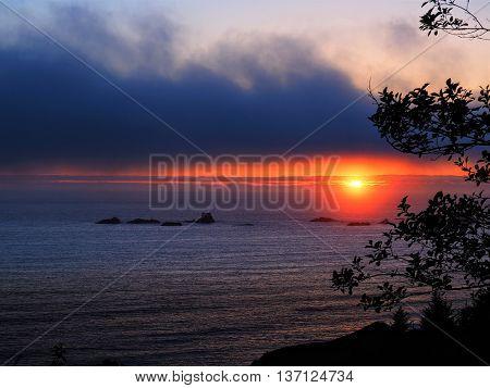 Stormy Moody Orange Sunset over Vast Ocean
