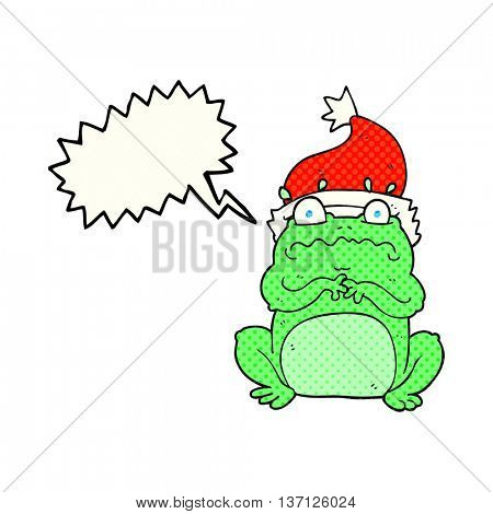 freehand drawn comic book speech bubble cartoon frog in christmas hat