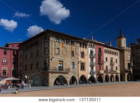 VIC, SPAIN- MAY 2016: VIC, SPAIN -JUNE 21, 2016: Main square of Vic on a sunny afternoon. On the balconies the pro-independence banners and flags.