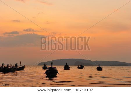Sunset Silhouette Longtail Boat At Beach