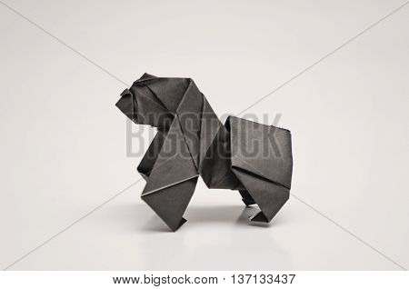 A black gorilla origami with white background