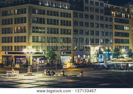 Berlin Germany - July 5 2016: Restaurants at the Gendarmenmarkt at night in Berlin Germany.