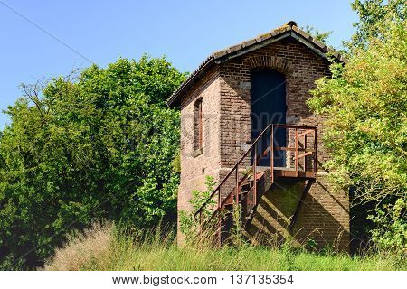 Strange little building with a highly oxidized iron staircase; it is completely unclear who is the owner and what is the purpose of this obscure cottage.