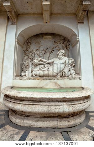 Renaissance Fountain statue representing river Arno symbol of Florence in quattro fontane square in Rome, Italy. By Domenico Fontana and Pietro Berrettini