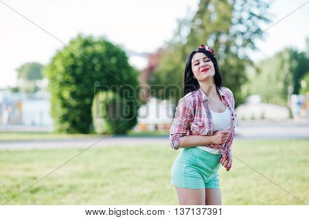Portrait Of Style Country Girl On Short Green Shorts And Crosscountry Checkered Line Shirt