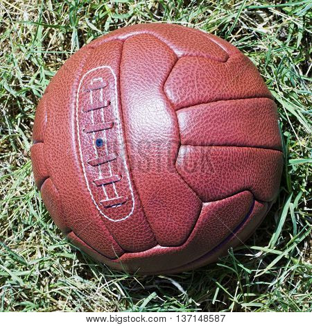 Vintage Football Over Grass Field