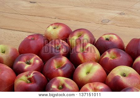 red-yellow nectarines on the bright wooden boards