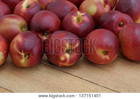 red nectarines on the pine wooden boards