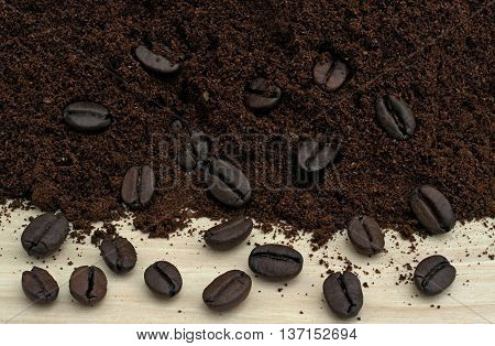 black coffee beans and black ground coffee
