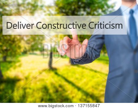 Deliver Constructive Criticism - Businessman Hand Pushing Button On Touch Screen