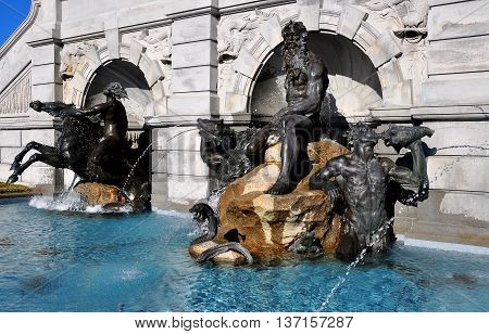 Washington DC - April 12 2014: Beaux arts Neptune Fountain by Roland Hinton Perry stands in front of the Library of Congress on First Street SE *
