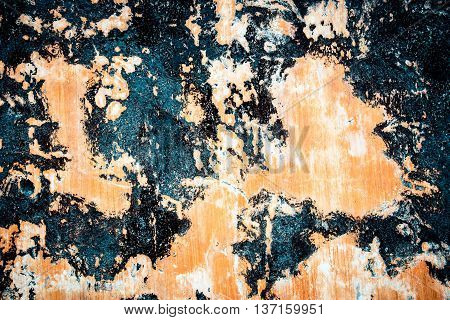 Stain on splashed asphalt of dripping on the white and orange wall, splashed black paint texture.