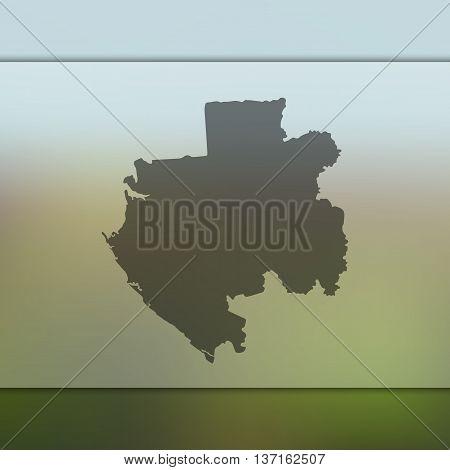 Gabon map on blurred background. Blurred background with silhouette of Gabon. Gabon.