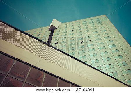 City skycraper with many glass windows retro style photography.
