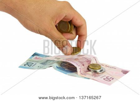 Hand counting money bills and coins on white background