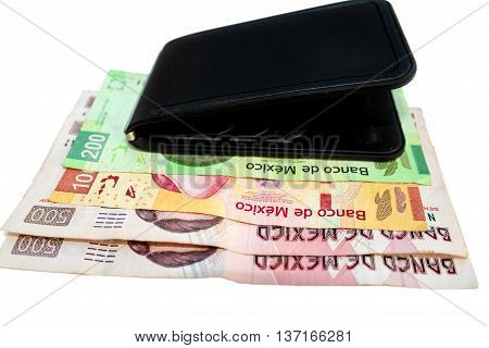 Mexican 500 200 and 100 currency Pesos bill alongside a wallet