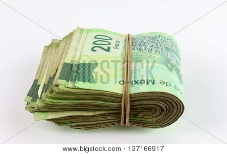 Stack of Mexican two hundred bills on white background