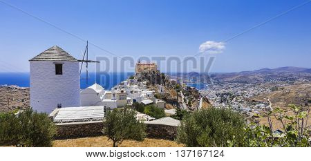 Traditional Greece - Syros island, view with windmill and cathedral