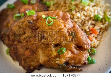Chinese egg fu yung omelette with fried rice at restaurant
