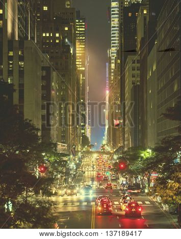 42nd Street in New York City with Grand Central and Times Square in the distance, focus in mid area of image with retro filter