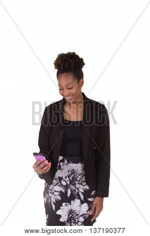 Young woman looking at her cell phone isolated on white