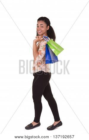 A young woman holding shopping bags. Isolated on white