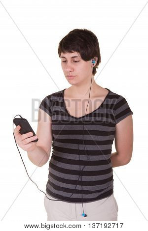 Portrait of a woman with earbuds connected to a cell phone