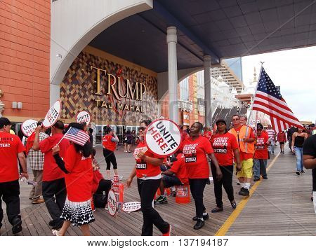 ATLANTIC CITY, NJ - JULY 4: Determined workers march in picket lines outside the Taj Mahal boardwalk casino, the 4th day of the strike for fair benefits on July 4, 2016 in Atlantic City, New Jersey.