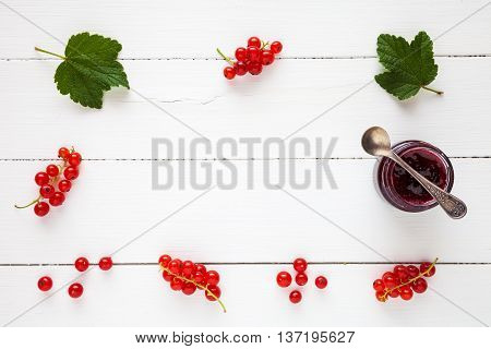 Red Currant Jam And Fresh Redcurrant Berries As Border With Copy Space On White Table. Flat Lay, Top