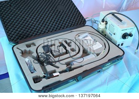 MOSCOW - APR 28, 2015: Suitcase with a gastroscope and a light source Pentax LH-150 PC in a modular tent of the field hospital