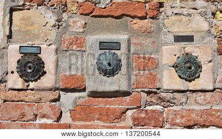 Characteristic three old door bell in Venice