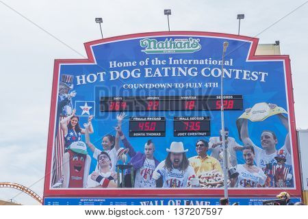 NEW YORK, JULY 4, 2016 - Nathan's hot dog eating contest countdown clock and 100th birthday of Nathan's Famous restaurant at the corner of Surf and Stillwell avenues, Coney Island