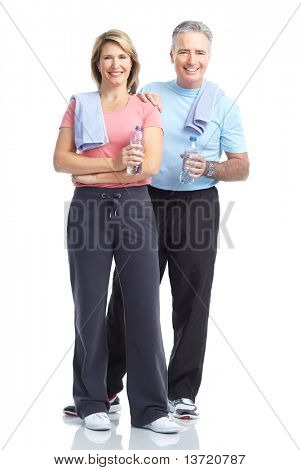 Gym & Fitness. Smiling elderly couple working out. Isolated over white background
