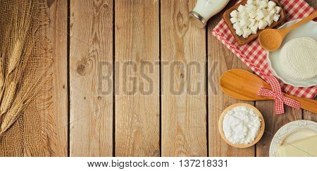 Farm fresh dairy products on wooden table. View from above. Flat lay
