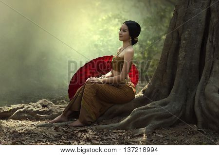 Thai woman in Thai Traditional dress in forest