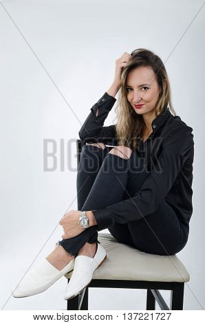 Young Blonde Isolated Lady Smiling Sitting On A Chair