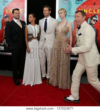 (L-R) Actors Henry Cavill, Alicia Vikaner, Armie Hammer, Elizabeth Debicki and director Guy Ritchie attend