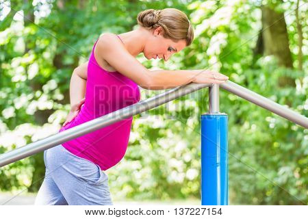 Pregnant woman doing pregnancy exercises on Fitness-Trail