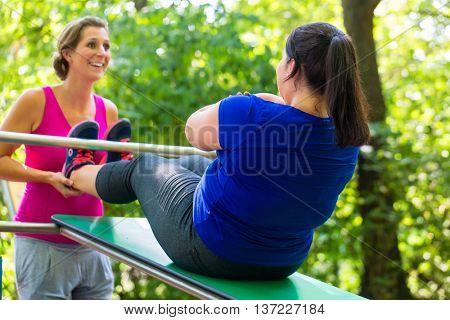 Women doing pregnancy exercises in nature