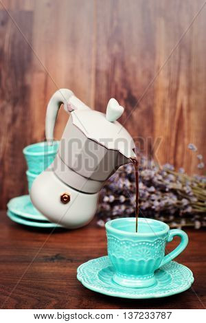 Levitation Coffee. Percolator Coffee With The Lid Closed. Pastel Blue Coffee Maker Pouring Coffee In
